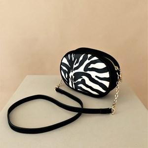 Zebra Print Suede Trim Mini Oval Bag